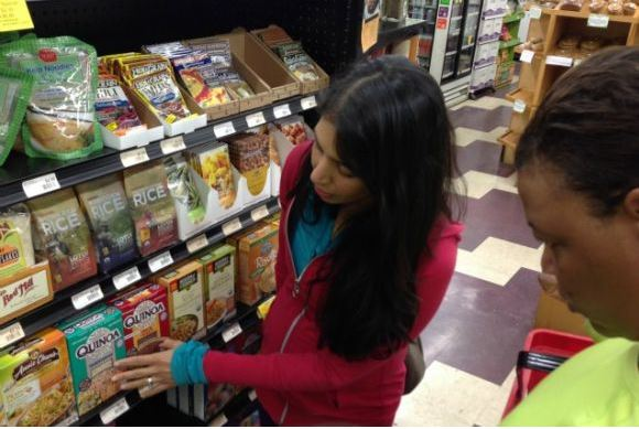 Food Babe, Vani Hari looking at food labels.
